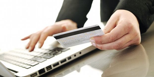 young business woman making online payment with credit card and representing concept of new age in banking and plastic money; Shutterstock ID 47804359; PO: aol; Job: production; Client: drone